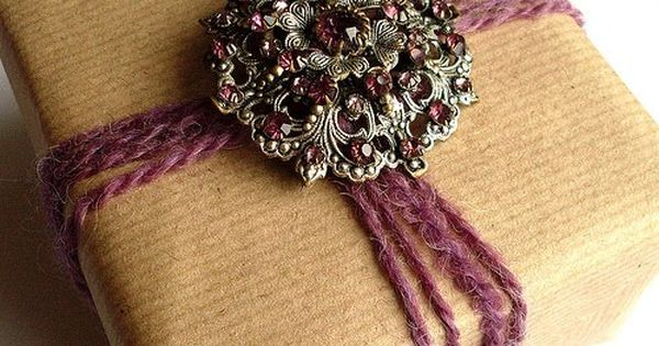 use vintage costume jewelry for gift packaging... great idea!