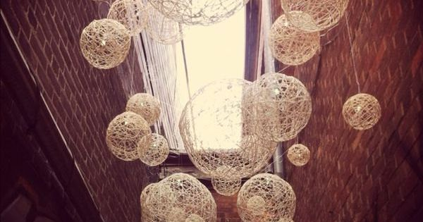 Wouldn't these handmade string lanterns make a beautiful subtle statement as reception