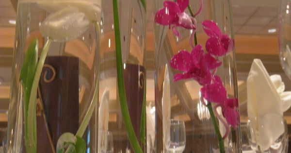 purple flowers orchids centerpiece submerged. | Wedding ...