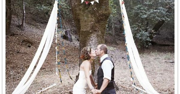 DIY Wedding Arch. This looks a little high, but it's due to