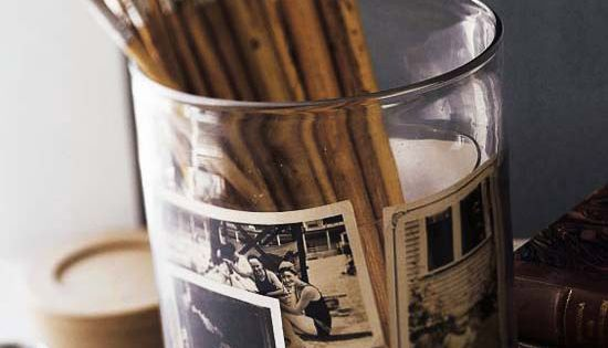 two apothecary jars nestled together to hold vintage photos and pencils/paintbrushes