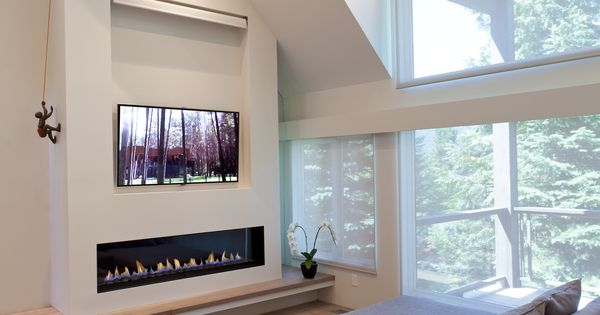 Linear Fireplace With Tile Surround And Tv Above Spark