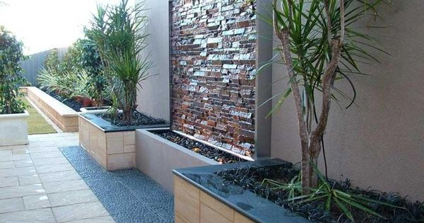 Water feature and landscaping along fence backyard ideas for Outdoor feature wall ideas