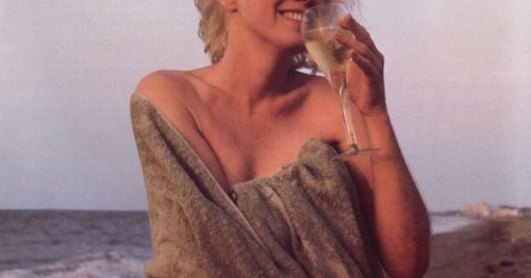 Vintage Marilyn Monroe Sipping White Wine On The Beach.