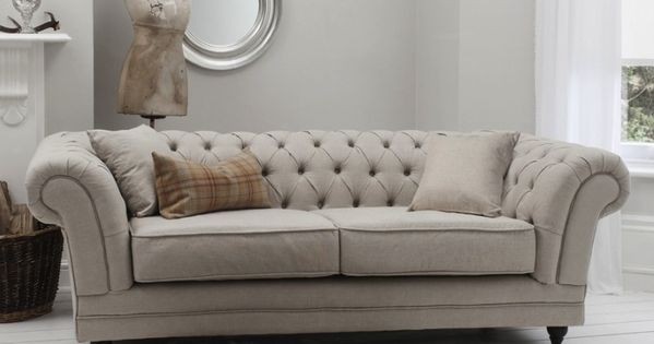 Furniture Inspiring White Theme In A Room Decorated With Chesterfield Sofa Accompanied Seat Cushions On It Modern Living