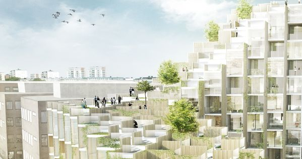 bjarke ingels group has unveiled plans for a foliage covered terraced block of apartments which are under construction in stockholms grdet distr