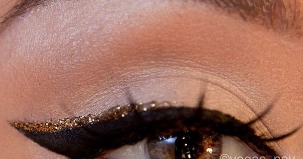 Thick black cat eye liner/winged eye liner with a touch of gold