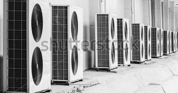 Group Of Air Conditioner Outdoor Units Outside Of Building Air