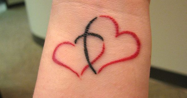 A very cool tattoo idea. Two hearts being joined together by a