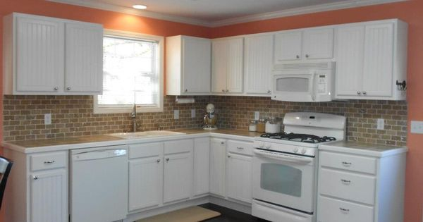 Coral kitchen cottage style kitchen peachy keen wall for Are white kitchen cabinets still in style