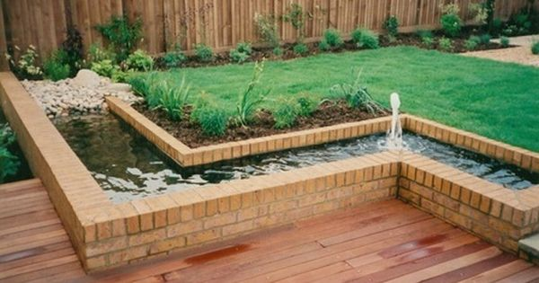 A raised water feature with low deck can change around to for Garden decking features