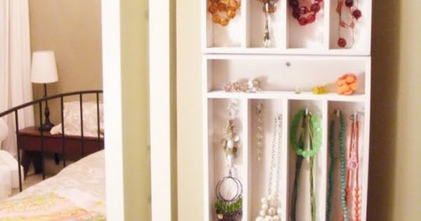 Cutlery trays on the wall to organize jewelry. Great idea.