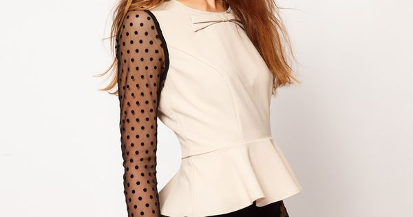 spotted sleeves and peplum top. love!