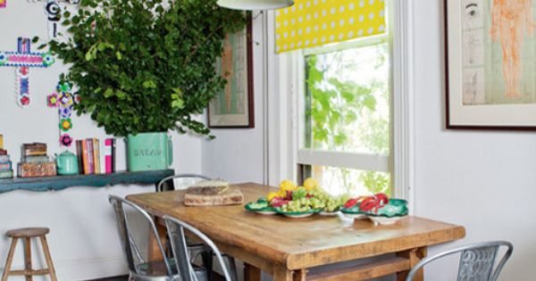 Bright color and white kitchen. Metal chairs arpund a wood table