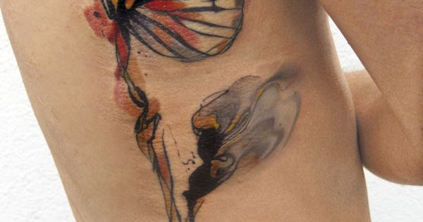 This is absolutely gorgeous! Butterfly watercolour tattoo ribs