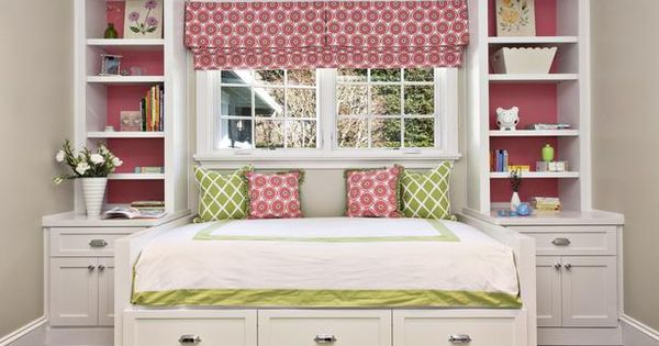 Daybed under long window with built-ins around and trundle under. Great for