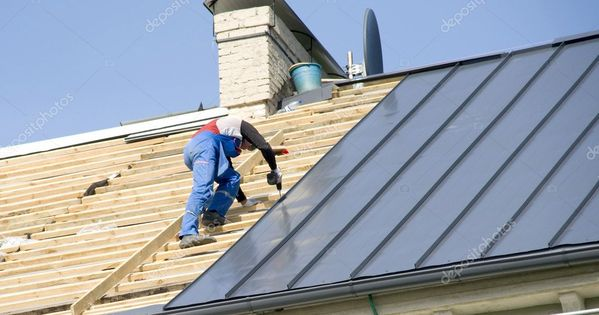 The Roofer Behind Work On Repair A Roof Stock Photo Affiliate Repair Work Roofer Photo Ad Roof Repair Roofing Contractors Roofing
