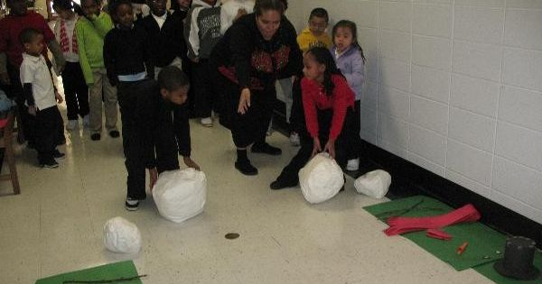 Christmas party ideas. Snowman building relay race.