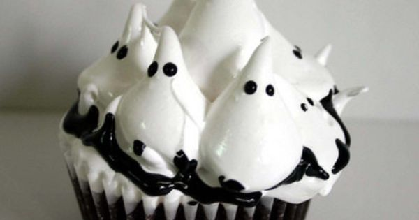 Cute Ghost cupcakes. This site has halloween ideas to make decorations for