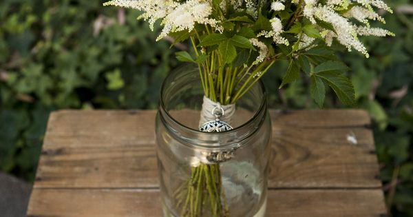 All cream astilbe, wrapped in natural twine and adorned with a locket from Etsy.