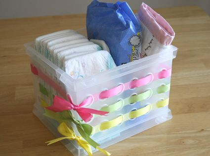 Embellish those cheap dollar store bins with ribbon -- babyshower giftbasket