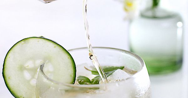 yummy drink! three-quarters of dry champagne or prosecco, a thinly sliced cucumber