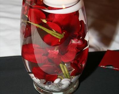 Centerpieces displayed a water submerged orchid, topped with a floating candle. Shades