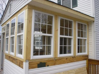sunroom windows house with porch