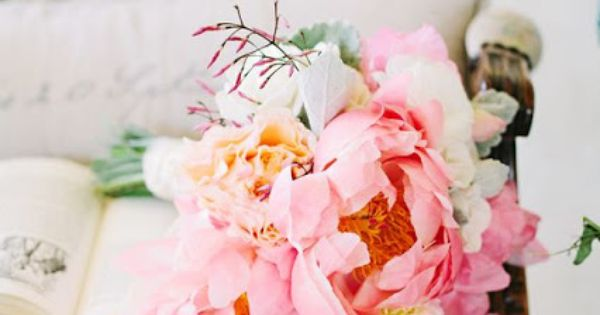 coral peonies, peach garden roses, white ranunculus and Icelandic poppies