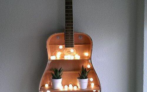 Turn An Old Guitar Into A Bohemian Style Shelf With Plants