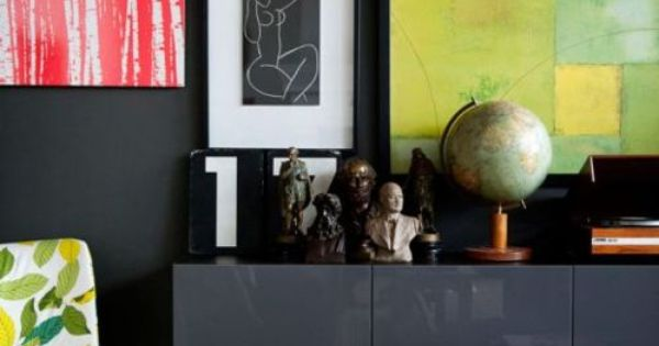 Black Wall and Black Details. A gallery wall with dark frames looks