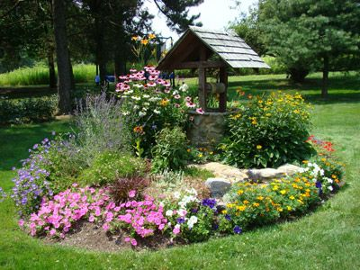 Landscape wishing wells with flowers of pleasure however go to the garden center to obtain - Flower and lawn landscaping ideas ...
