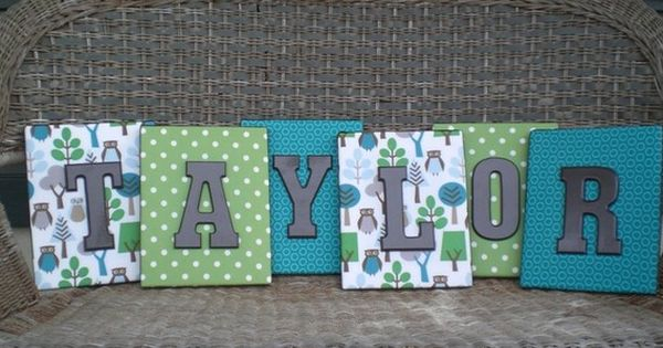 Canvas covered with scrapbook paper then painted wood letters! We have all