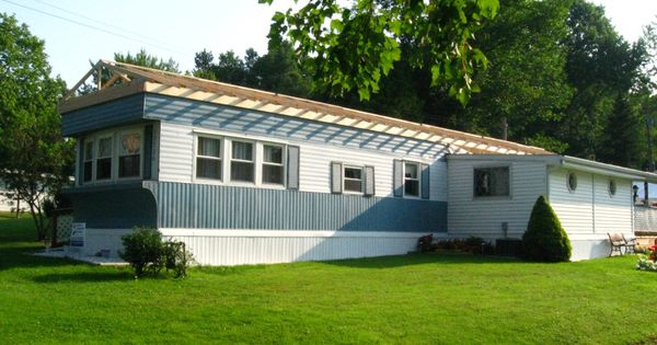 Conneaut lake area mobile home has a roof built over it for Mobile home garage kits