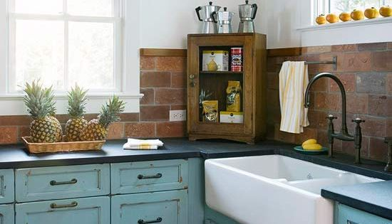 Pretty cabinet color! A salvaged brick backsplash adds cottage charm to this
