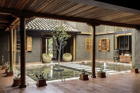 Central Courtyard Of The Home With A Reflective Pond And Walkway Courtyard Design Rustic Home Design Courtyard House