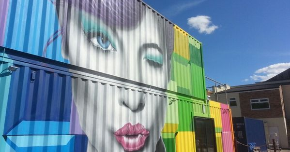 New graffiti on their split level for Village craft container home