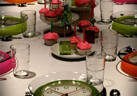 New Year's Eve table setting idea with dollar store clocks. Cute dinner