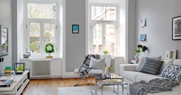 Light grey walls give a crisp bright feel to this living - Gray walls in living room ...