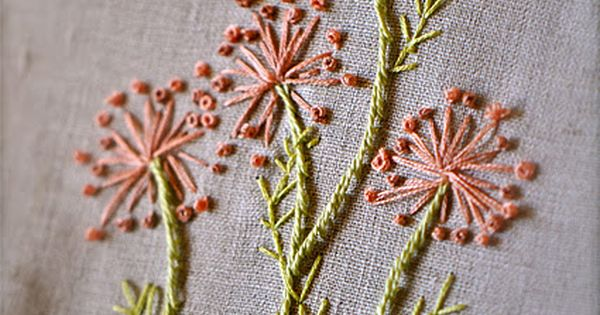 beautifully embroidered flowers: french knots, stem stitch and back stitch on linen