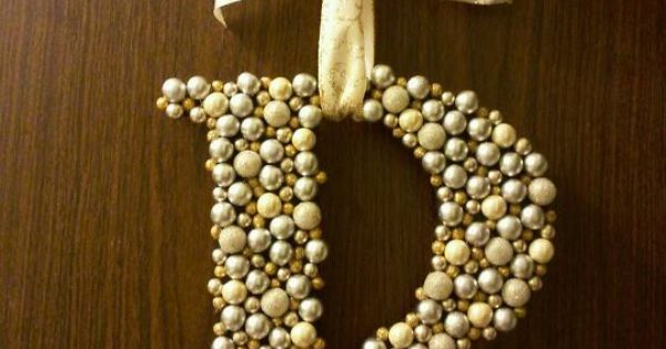 Letter 'wreath' made by gluing Christmas berries from the craft store to