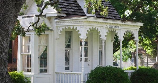 Love the gingerbread on the porch -- what a sweet little cottage