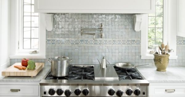 Glass tile backsplash and love the little windows on each side of