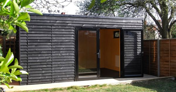 Garden room in crouch end with gym and storage black for Garden office gym