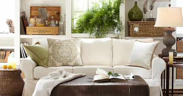 home decor stores like pottery barn like this neutral living room and green pillow from 13374