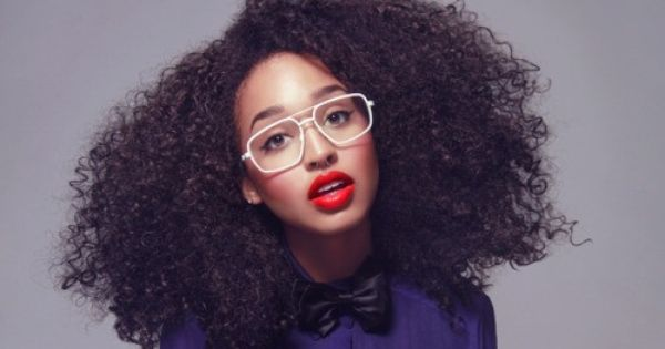 Natural hair. Cute makeup, glasses, and bowtie