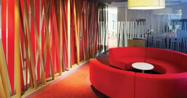 Bright and colorful office design of a company red sofa for Modern office decor accessories