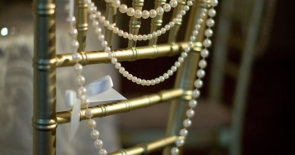 Bead chair decor for bride and groom