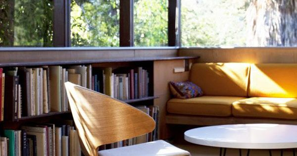 low shelves under high windows to maximize natural light in a reading