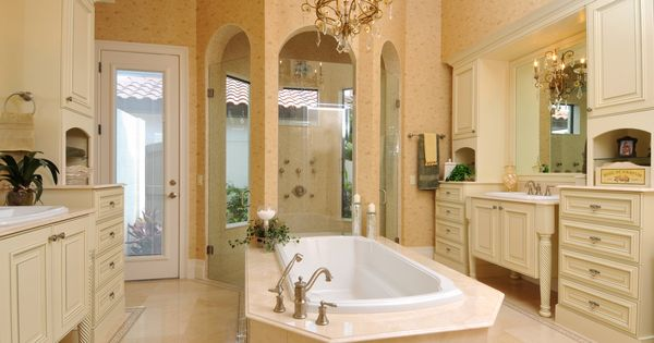 The master bath has crema marfil marble flooring with his for Opposite of floor